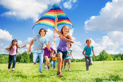 Many active kids with kite